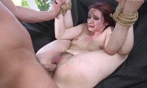 Redhead bide one's time procurement spanked, mouth screwed plus sodomized