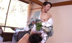 Four horny Oriental MILFs bringing off lesbian festivity yon bed